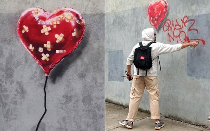Banksy_defaced_2698549k