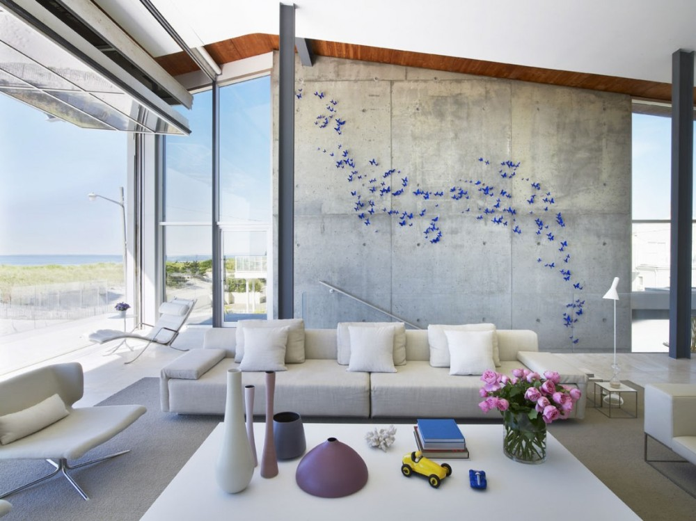 Concrete-wall-breezy-room-and-small-purple-butterflies